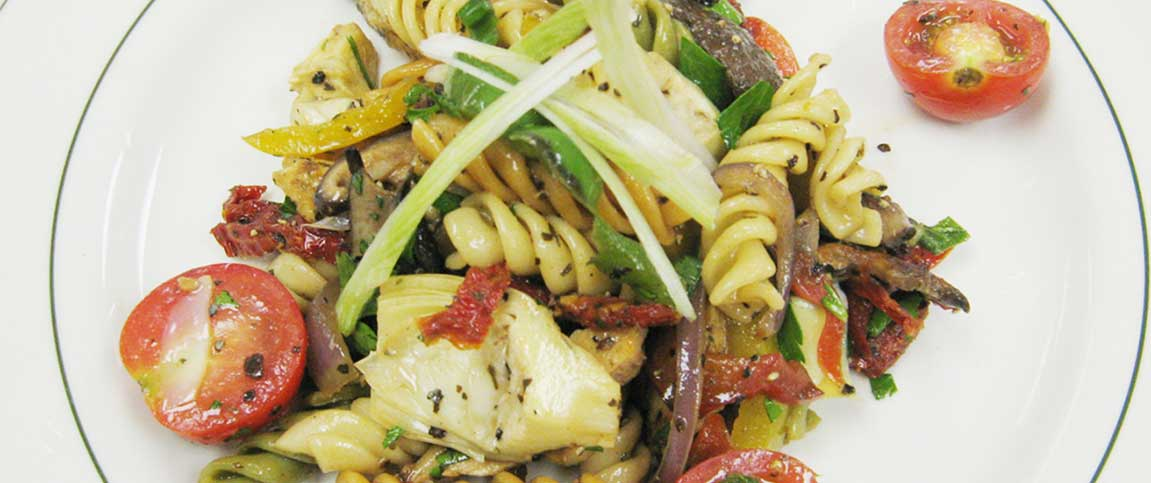 Meat and Vegetable Medley Over Rotini Pasta