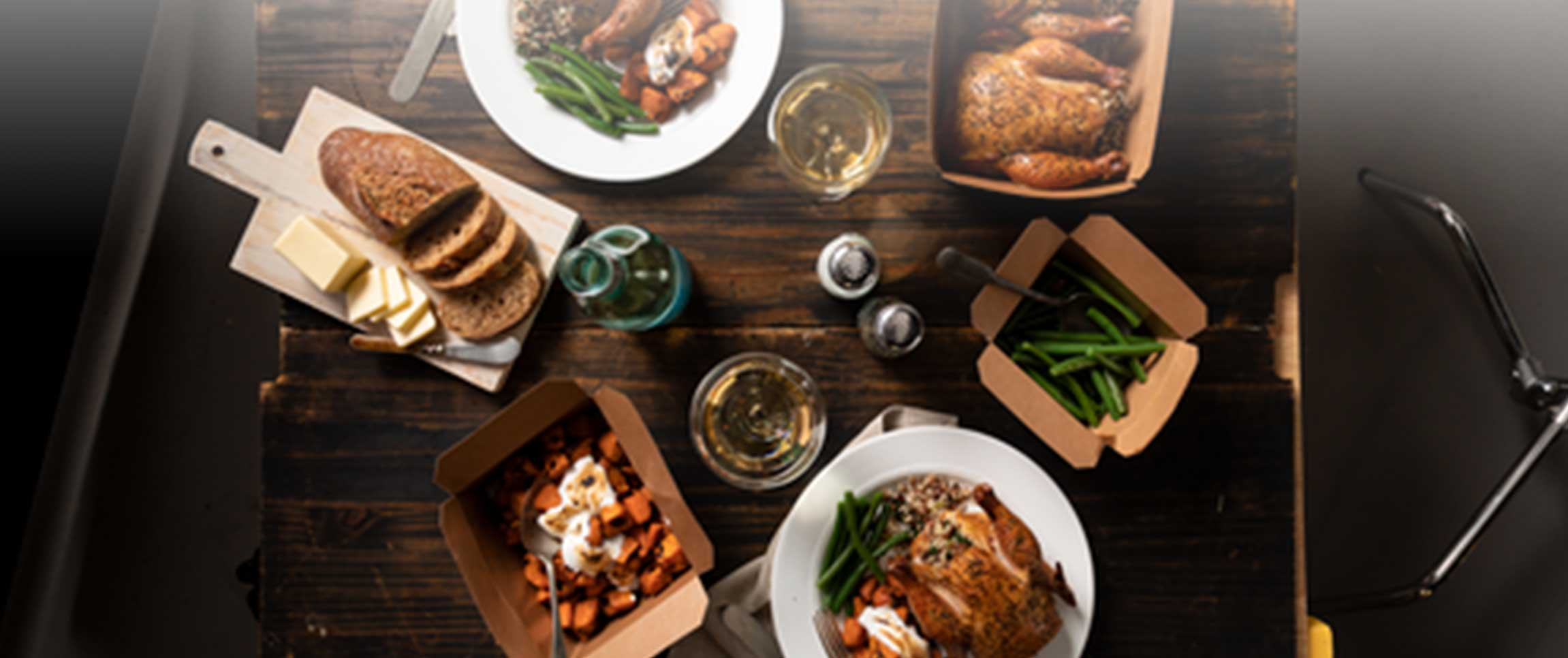 Cornish Game Hen takeout meal on table with side options